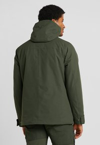 Jack Wolfskin - WEST JACKET - Kurtka Outdoor - dark moss - 2