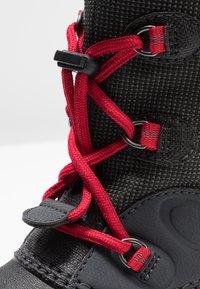 Jack Wolfskin - ICELAND TEXAPORE HIGH - Zimní obuv - black/red - 2