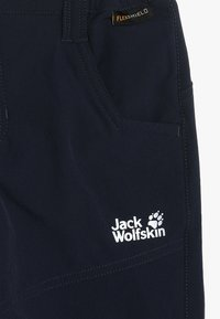 Jack Wolfskin - RASCAL WINTER PANTS KIDS - Pantalones - midnight blue
