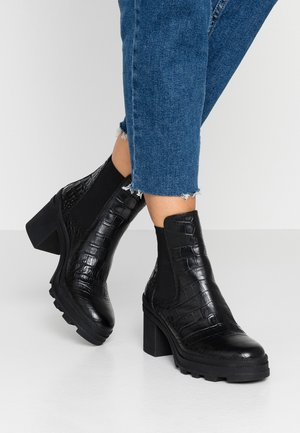 Kotníkové boty na platformě - miranda nero
