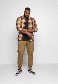 Jack´s Sportswear - BASIS TEE SINGLE 2 PACK - Basic T-shirt - black - 0