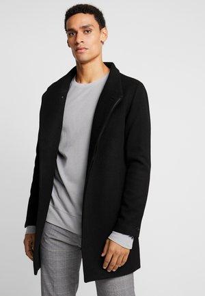 JPRCOLLUM - Short coat - black