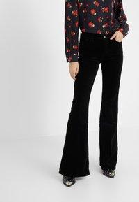 J Brand - VALENTINA - Flared Jeans - black - 0