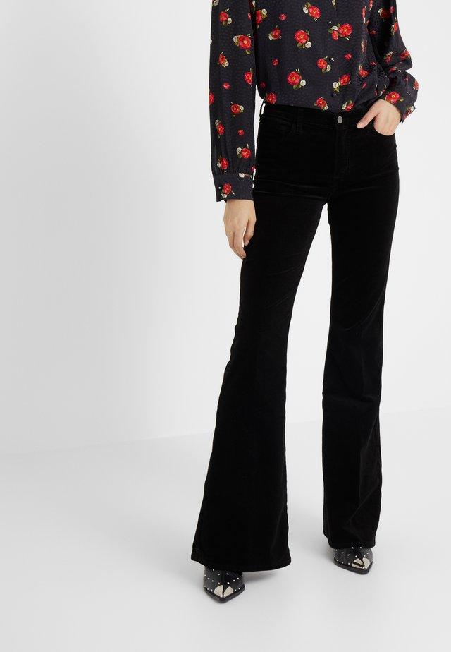 VALENTINA - Flared jeans - black