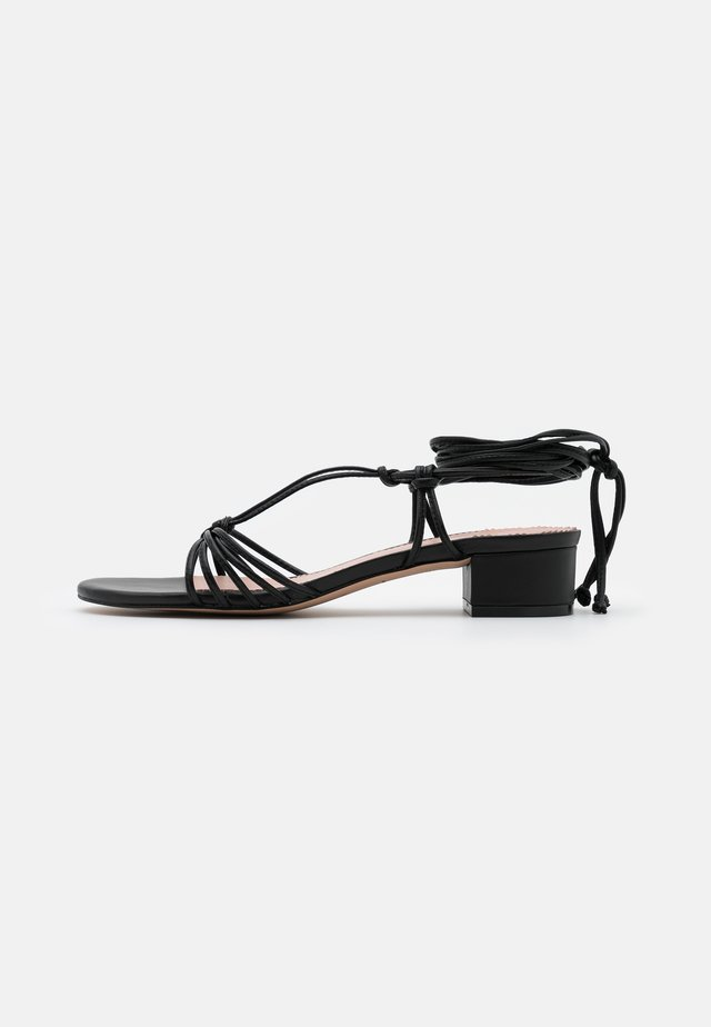 KNOTTED TSTRAP FLORA - Sandals - black