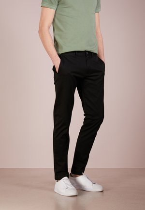 CORE STRETCH - Chino kalhoty - black