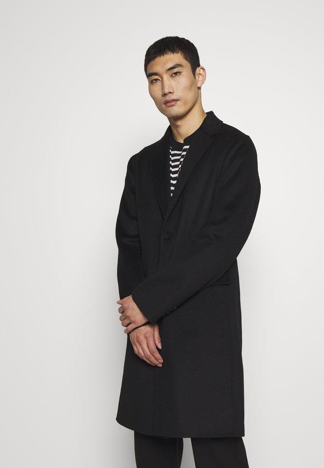 ARMAND - Classic coat - black