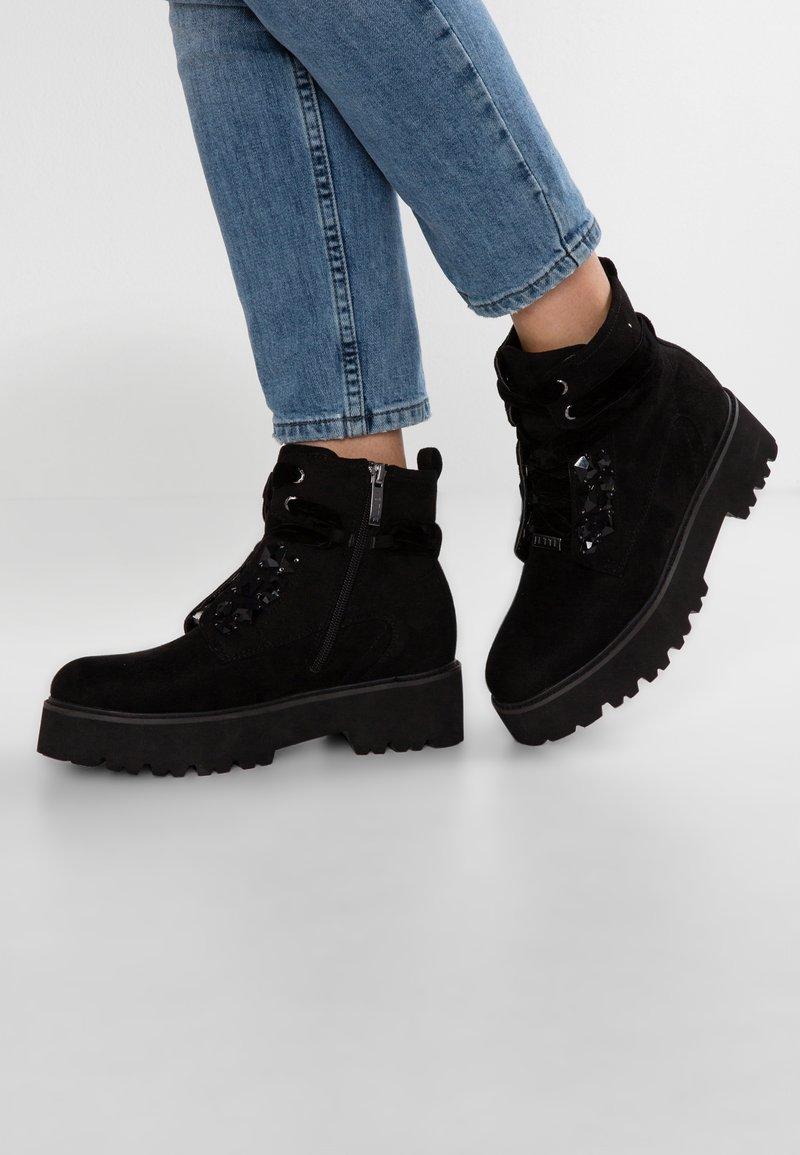 JETTE - Boots à talons - black