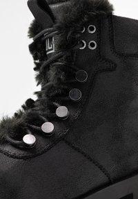 JETTE - Platform ankle boots - black - 2