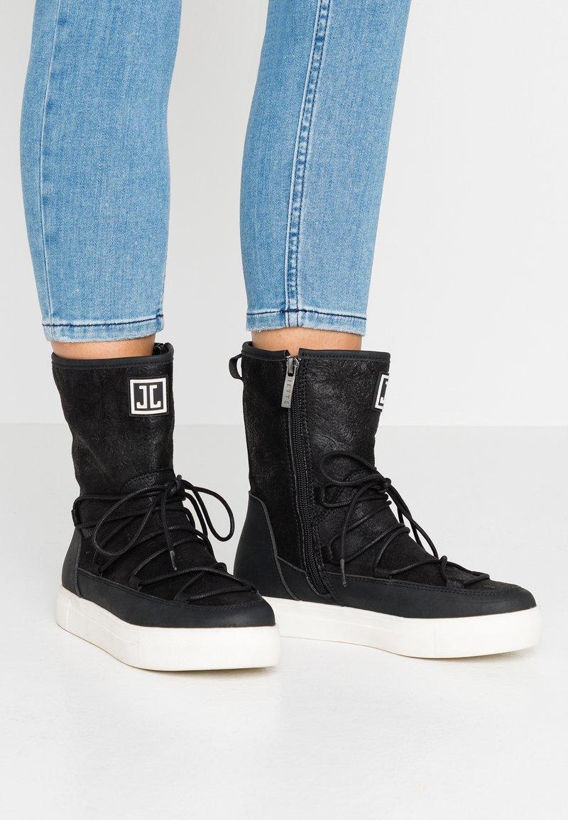 JETTE - Kotníkové boty - black