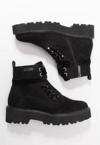 JETTE - Kotníkové boty na platformě - black - 3