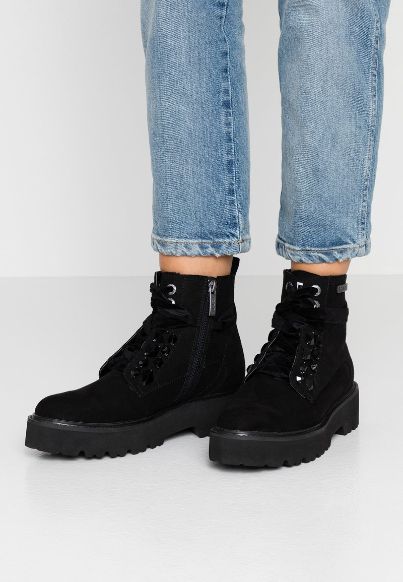 JETTE - Platform ankle boots - black