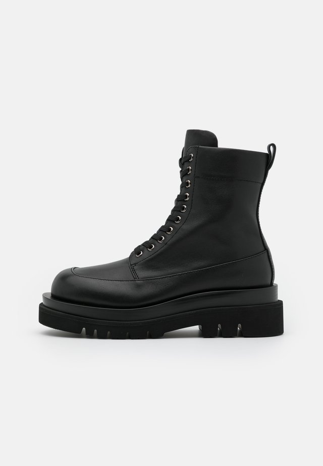 DIABOL LOW  - Platform ankle boots - black
