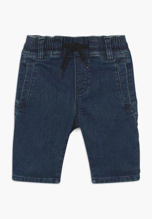 BERMUDA - Denim shorts - medium blue