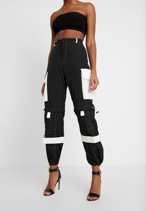 ZIP OFF OVERSIZED TROUSER - Träningsbyxor - black/white