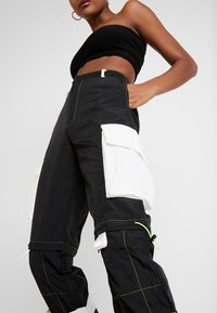 Jaded London - ZIP OFF OVERSIZED TROUSER - Tracksuit bottoms - black/white - 5