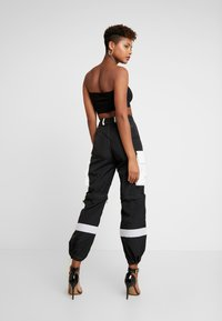Jaded London - ZIP OFF OVERSIZED TROUSER - Tracksuit bottoms - black/white - 3