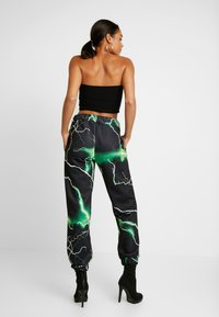 Jaded London - PRINTED CUFF HEM - Tracksuit bottoms - black/green - 2