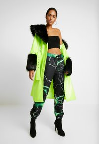 Jaded London - PRINTED CUFF HEM - Tracksuit bottoms - black/green - 1