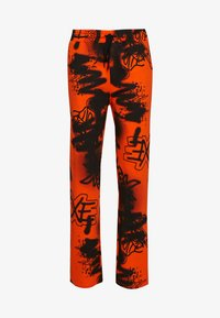 Jaded London - GRAFFITI PRINT JOGGER - Tracksuit bottoms - orange/black - 0