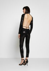 Jaded London - LONG SLEEVE LUREX CATSUIT WITH THONG BACK DETAIL - Tuta jumpsuit - black