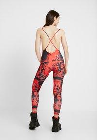 Jaded London - SQUARE NECK PRINTED GRAFFITI PRINT - Jumpsuit - red/black - 2