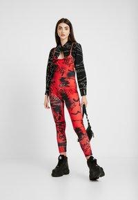 Jaded London - SQUARE NECK PRINTED GRAFFITI PRINT - Jumpsuit - red/black - 1