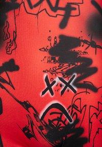 Jaded London - SQUARE NECK PRINTED GRAFFITI PRINT - Jumpsuit - red/black - 5