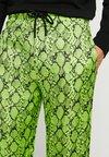 Jaded London - SNAKESKIN PANT - Trousers - neon green