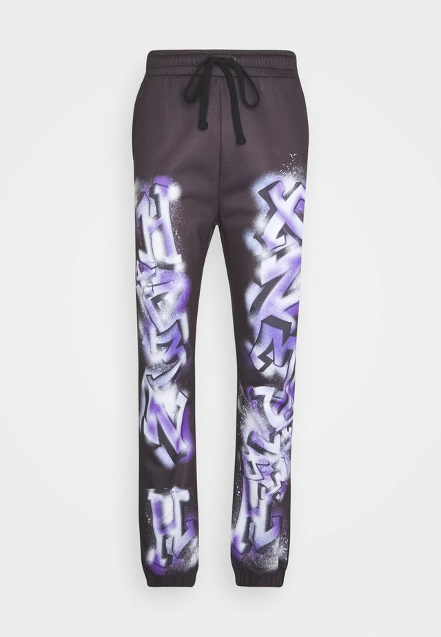 GRAFFITI JOGGERS - Tracksuit bottoms - black