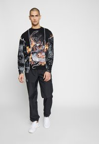 Jaded London - CUT AND SEW SKULL FLAME TOP - Maglietta a manica lunga - black - 1