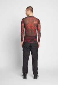 Jaded London - SPACE GAME TOP - Maglietta a manica lunga - red - 2