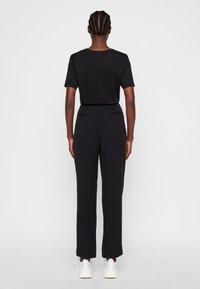 J.LINDEBERG - HOSE KAIA - Spodnie materiałowe - black - 2