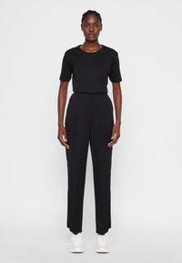 J.LINDEBERG - HOSE KAIA - Spodnie materiałowe - black - 1