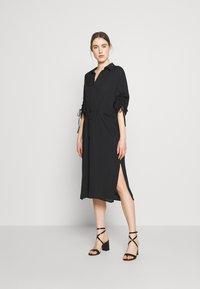 J.LINDEBERG - ZAPPA SEMI TRANSPARENT - Day dress - black - 1