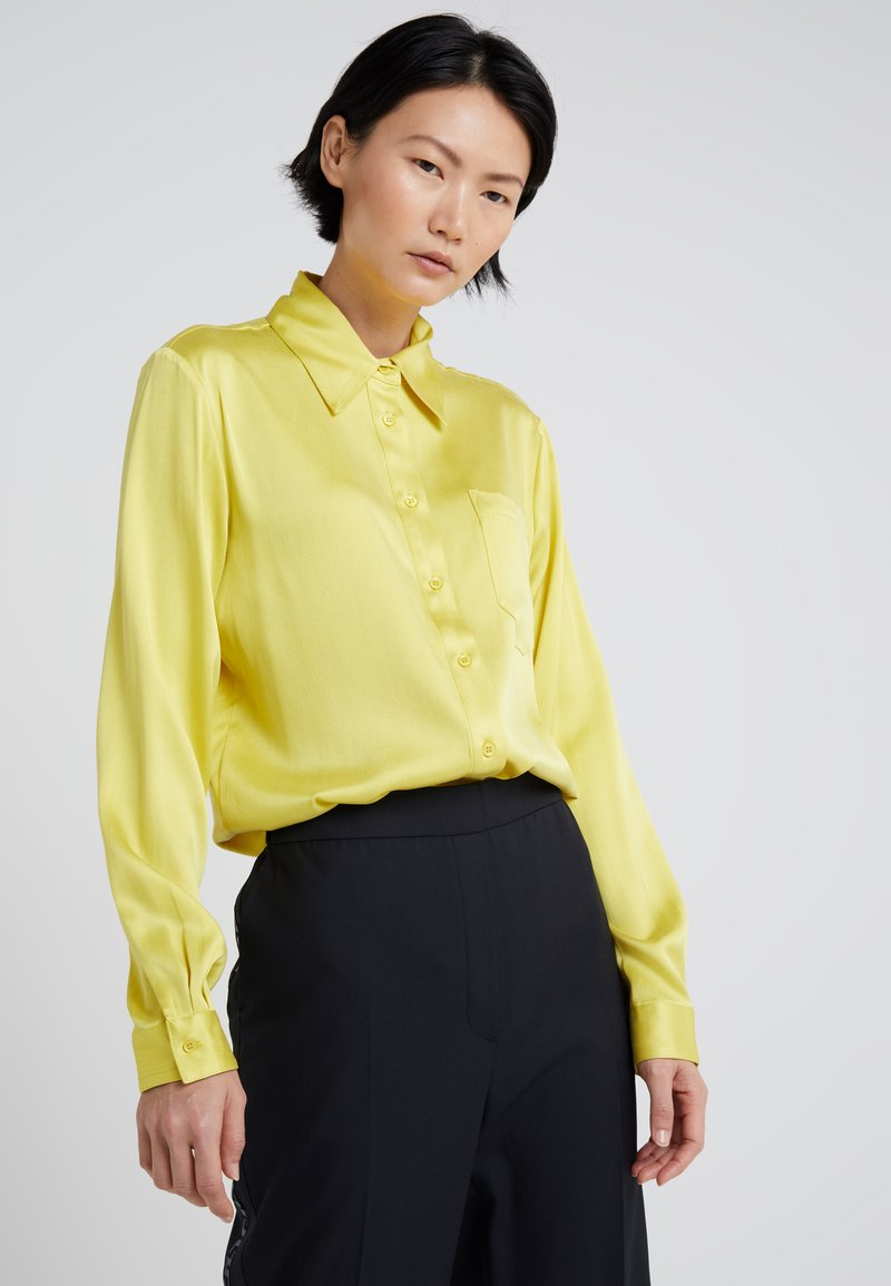 J.LINDEBERG - MALLORY WASHED - Button-down blouse - brocken yellow