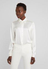 J.LINDEBERG - MALLORY - Button-down blouse - cloud white - 0