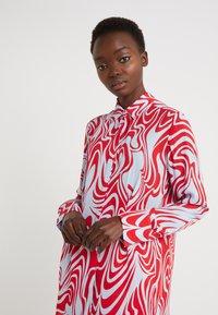 J.LINDEBERG - EDDIE - Button-down blouse - red swirl - 0