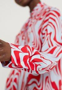 J.LINDEBERG - EDDIE - Button-down blouse - red swirl - 5