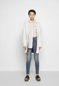 J.LINDEBERG - UMA ACTIVE - Jeans Skinny Fit - light blue - 1