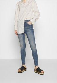 J.LINDEBERG - UMA ACTIVE - Jeans Skinny Fit - light blue - 0