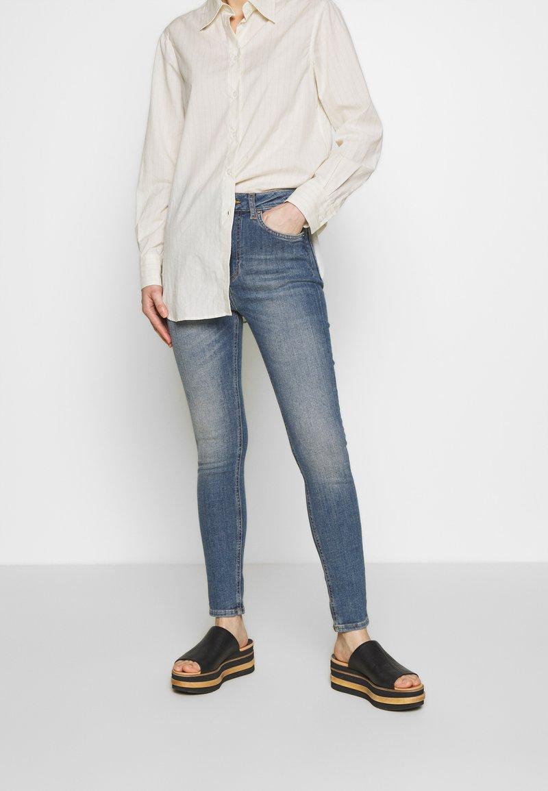 J.LINDEBERG - UMA ACTIVE - Jeans Skinny Fit - light blue