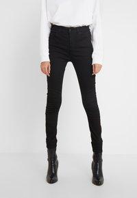 J.LINDEBERG - UMA-RE ACTIVE - Jeans Skinny Fit - black - 0