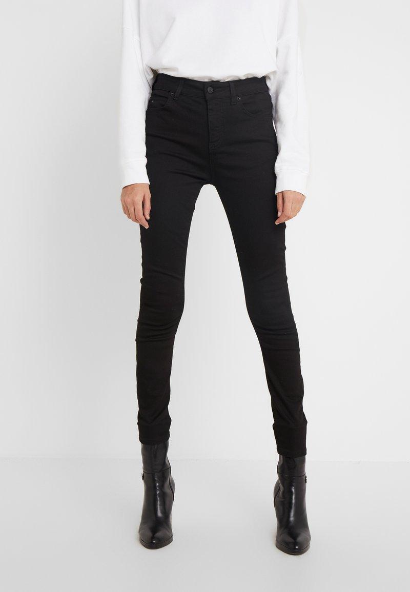 J.LINDEBERG - UMA-RE ACTIVE - Jeans Skinny Fit - black