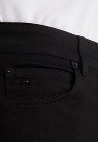 J.LINDEBERG - UMA-RE ACTIVE - Jeans Skinny Fit - black - 4