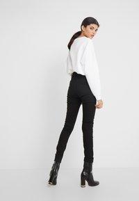 J.LINDEBERG - UMA-RE ACTIVE - Jeans Skinny Fit - black - 2