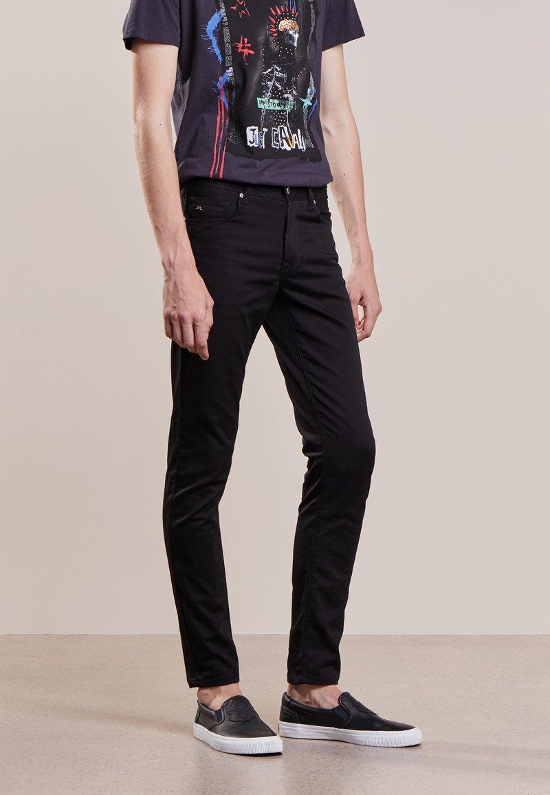 J.LINDEBERG - DAMIEN - Slim fit jeans - black