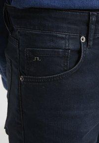 J.LINDEBERG - JAY ADDER - Jeans slim fit - blue/black - 4