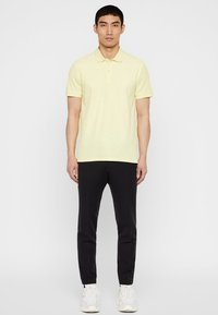 J.LINDEBERG - TROY CLEAN - Polo shirt - still yellow
