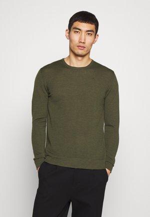 Stickad tröja - covert green